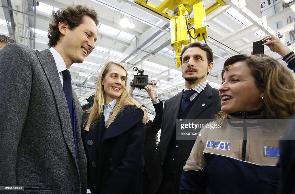 John Elkann, chairman of Fiat SpA, left, is greeted by an employee during the inauguration of Maserati's Grugliasco factory in Turin, Italy, on Wednesday, Jan. 30, 2013. Fiat SpA Chief Executive Officer Sergio Marchionne said the Italian carmaker narrowed losses in Europe in the fourth quarter, helping it achieve full-year earnings that were in line with its forecasts. Photographer: Alessia Pierdomenico/Bloomberg via Getty Images