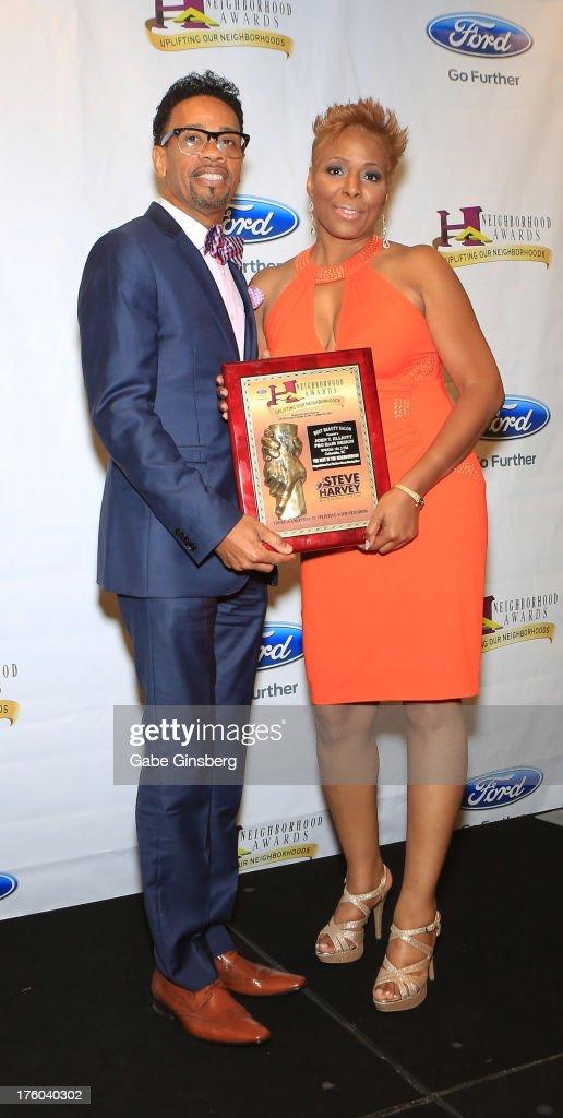 John Elliott (L) and Avis Tillmon receive the award for Best Beauty Salon for John T. Elliott Pro Hair Design from Columbia, South Carolina at the 11th annual Ford Neighborhood Awards at the MGM Grand Garden Arena on August 10, 2013 in Las Vegas, Nevada.