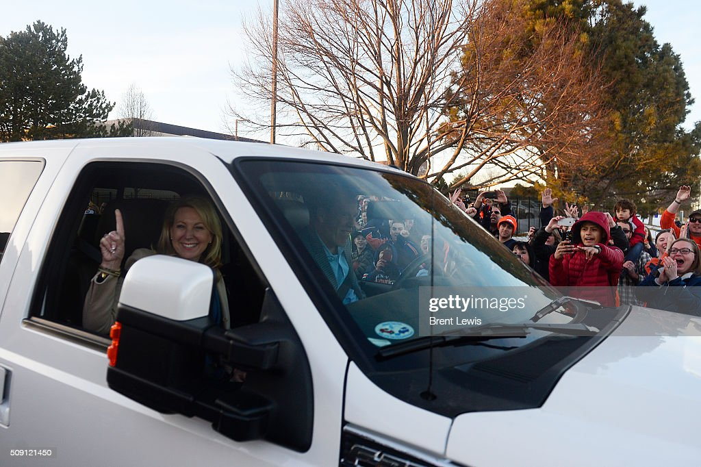 John Elway and his daughter, Jessica, leave Dove Valley on February 8, 2016 in Centennial, Colorado. Fans cheered for the Denver Broncos when they returned home after defeating the Carolina Panthers to win Super Bowl 50.