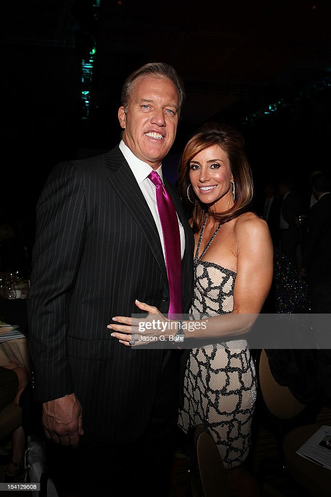 <a gi-track='captionPersonalityLinkClicked' href=/galleries/search?phrase=John+Elway&family=editorial&specificpeople=204173 ng-click='$event.stopPropagation()'>John Elway</a> (L) and Paige Green attend the Be Beautiful Be Yourself Fashion Show at Sheraton Downtown Denver Hotel on October 13, 2012 in Denver, Colorado.