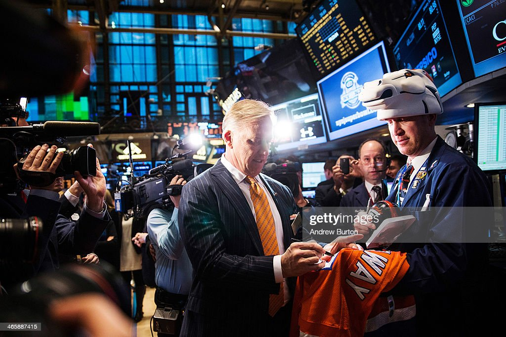 <a gi-track='captionPersonalityLinkClicked' href=/galleries/search?phrase=John+Elway&family=editorial&specificpeople=204173 ng-click='$event.stopPropagation()'>John Elway</a>, executive VP of football operations of the Denver Broncos, signs a jersey on the floor of the New York Stock Exchange (NYSE) on the morning of January 30, 2014 in New York City. The NYSE welcomed members of the Super Bowl Host Committee, owners and managers of the Denver Broncos and Seattle Seahawks to ring the opening bell today.