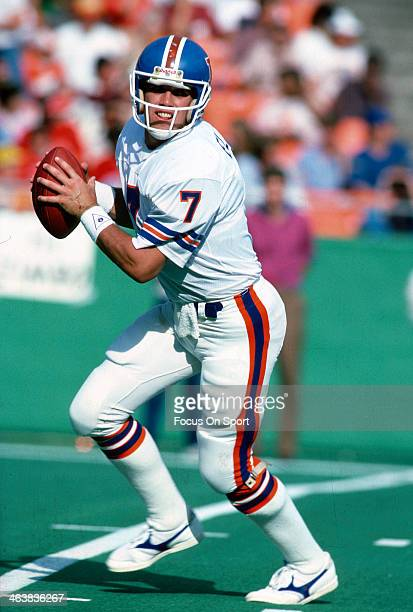 John Elway of the Denver Broncos drops back to pass against the Kansas City Chiefs during an NFL football game October 27 1985 at Arrowhead Stadium...