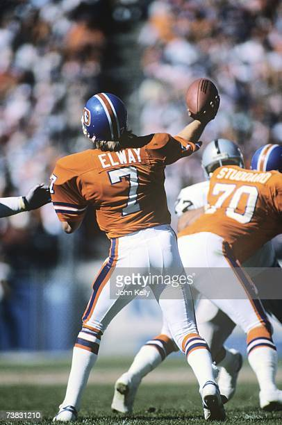John Elway of the Denver Broncos throws a pass against the Los Angeles Raiders at Mile High Stadium on September 30 1984 in Denver Colorado