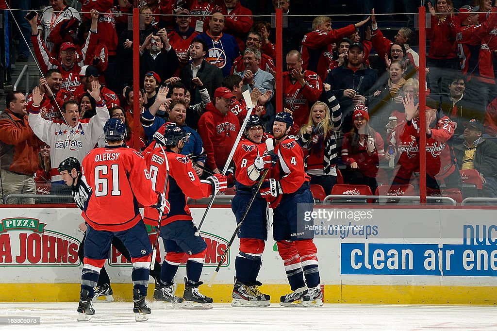 John Erskine #4 celebrates with Alex Ovechkin #8, Mike Ribeiro #9, and Steven Oleksy #61 of the Washington Capitals after scoring a goal during an NHL game against the Florida Panthers at Verizon Center on March 7, 2013 in Washington, DC.
