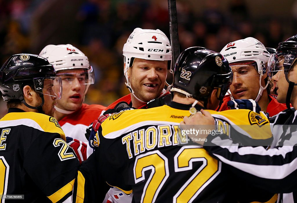 <a gi-track='captionPersonalityLinkClicked' href=/galleries/search?phrase=John+Erskine&family=editorial&specificpeople=215268 ng-click='$event.stopPropagation()'>John Erskine</a> #4 of the Washington Capitals and <a gi-track='captionPersonalityLinkClicked' href=/galleries/search?phrase=Shawn+Thornton&family=editorial&specificpeople=221639 ng-click='$event.stopPropagation()'>Shawn Thornton</a> #22 of the Boston Bruins have words after the whistle during a game at the TD Garden on March 1, 2014 in Boston, Massachusetts.