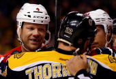 John Erskine of the Washington Capitals and Shawn Thornton of the Boston Bruins have words after the whistle during a game at the TD Garden on March...