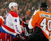 John Erskine of the Washington Capitals and Vincent Lecavalier of the Philadelphia Flyers exchange words before they fight in the first period at...