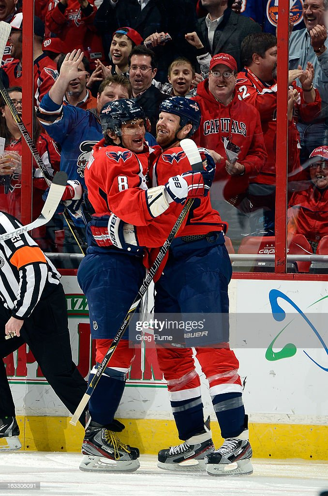 John Erskine #4 of the Washington Capitals celebrates with Alex Ovechkin #8 after scoring in the first period against the Florida Panthers at the Verizon Center on March 7, 2013 in Washington, DC.