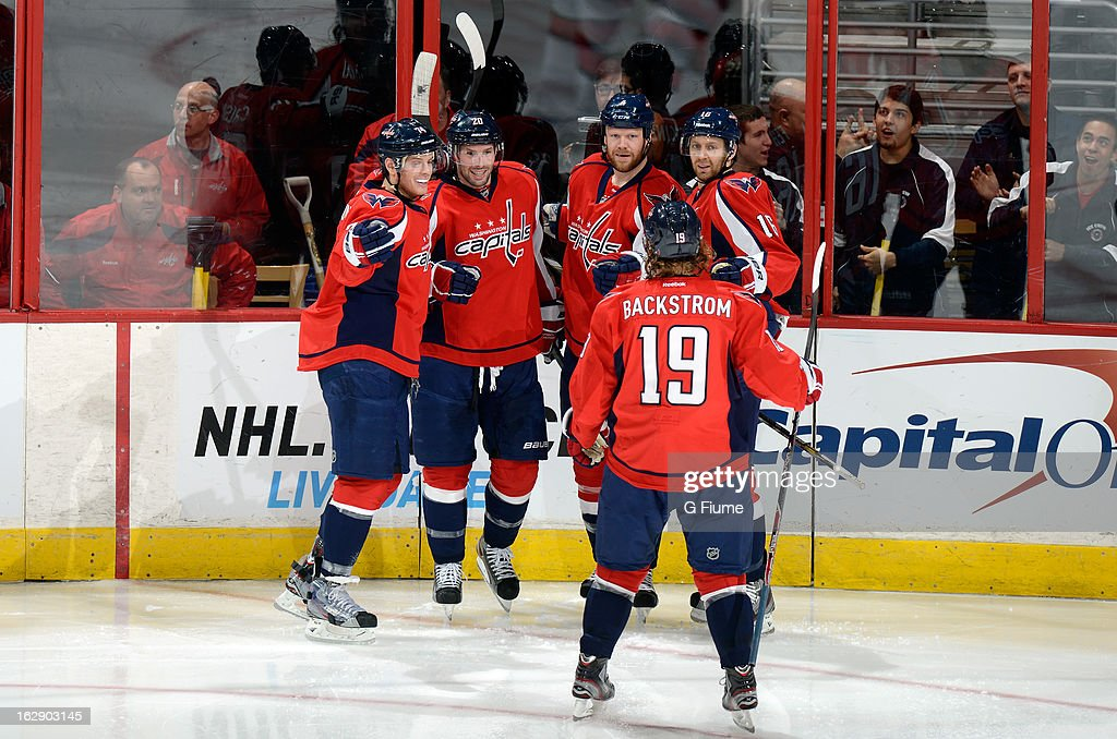 John Erskine #4 of the Washington Capitals celebrates with John Carlson #74,Troy Brouwer #20, Nicklas Backstrom #19 and Eric Fehr #16 after scoring against the Carolina Hurricanes at the Verizon Center on February 26, 2013 in Washington, DC.