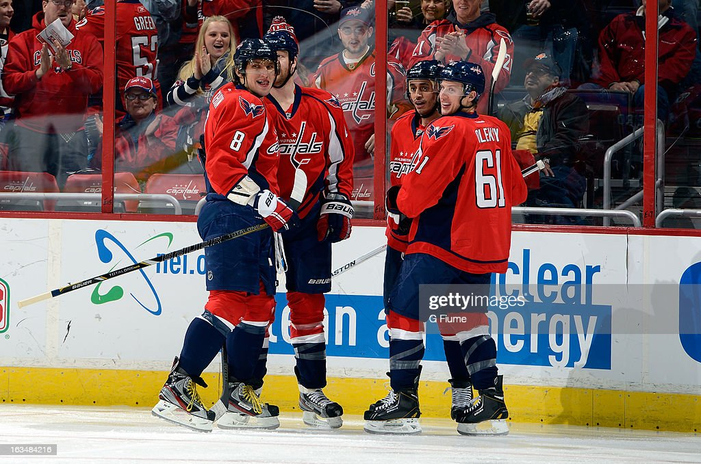 John Erskine #4 of the Washington Capitals celebrates with teammates after scoring in the first period against the Florida Panthers at the Verizon Center on March 7, 2013 in Washington, DC.