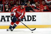 John Erskine of the Washington Capitals controls the puck in the first period during an NHL game against the Buffalo Sabres at Verizon Center on...