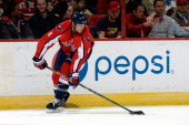 John Erskine of the Washington Capitals controls the puck in the first period during an NHL game against the Detroit Red Wings at Verizon Center on...