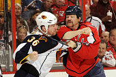 John Erskine of the Washington Capitals fights Eric Boulton of the Atlanta Thrashers during a NHL hockey game on November 14 2010 at the Verizon...
