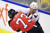 John Erskine of the Washington Capitals fights with Bracken Kearns of the Florida Panthers during a NHL game on December 5 2011 at the BankAtlantic...