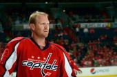 John Erskine of the Washington Capitals in action during an NHL game against the Tampa Bay Lightning at Verizon Center on April 7 2013 in Washington...