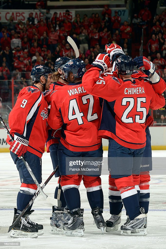 <a gi-track='captionPersonalityLinkClicked' href=/galleries/search?phrase=John+Erskine&family=editorial&specificpeople=215268 ng-click='$event.stopPropagation()'>John Erskine</a> #4 of the Washington Capitals is congratulated by teamates after scoring in the second period of an NHL hockey game against the Buffalo Sabres at Verizon Center on January 27, 2013 in Washington, DC.