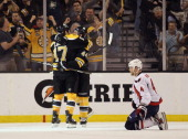 John Erskine of the Washington Capitals kneels on the ice following a goal by Dennis Seidenberg of the Boston Bruins at 1721 of the second period in...