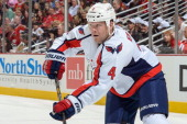 John Erskine of the Washington Capitals looks up the ice during the NHL game against the Chicago Blackhawks on October 1 2013 at the United Center in...