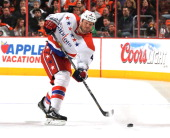 John Erskine of the Washington Capitals passes the puck in the first period against the Philadelphia Flyers at Wells Fargo Center on March 5 2014 in...