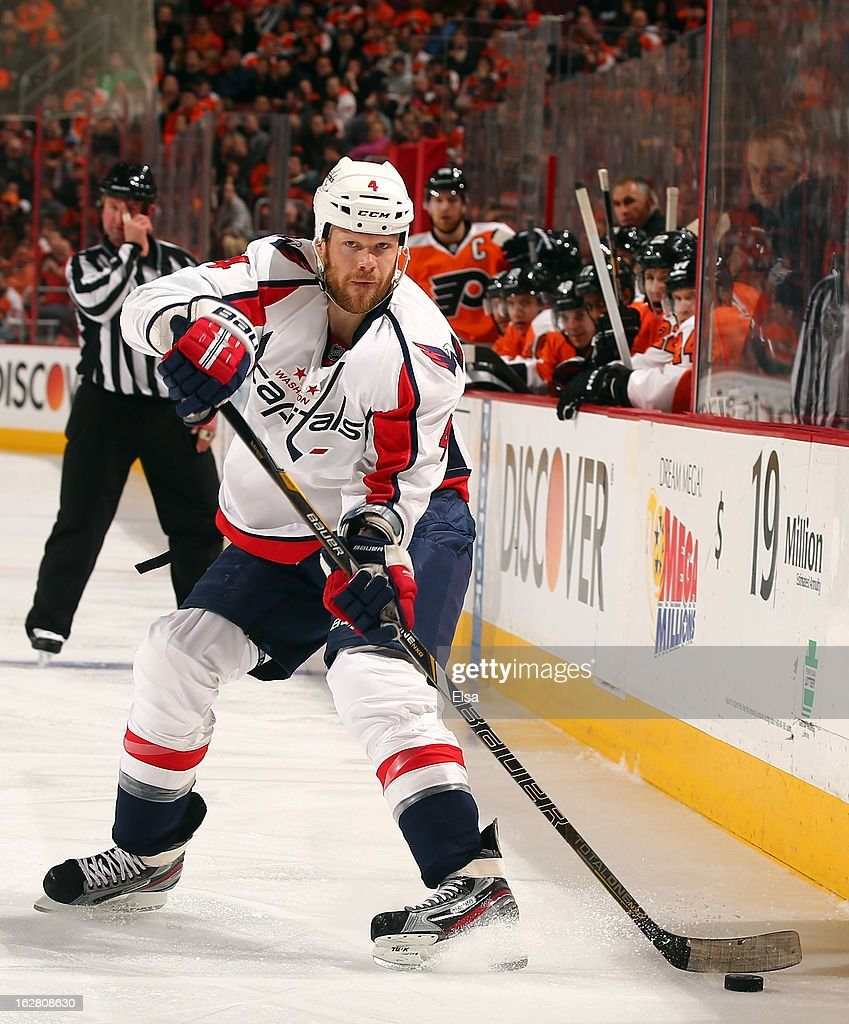 <a gi-track='captionPersonalityLinkClicked' href=/galleries/search?phrase=John+Erskine&family=editorial&specificpeople=215268 ng-click='$event.stopPropagation()'>John Erskine</a> #4 of the Washington Capitals passes the puck in the third period against the Philadelphia Flyers on February 27, 2013 at the Wells Fargo Center in Philadelphia, Pennsylvania. The Philadelphia Flyers defeated the Washington Capitals 4-1.