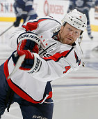 John Erskine of the Washington Capitals shoots during warmup before NHL action at The Air Canada Centre November 19 2011 in Toronto Ontario Canada...