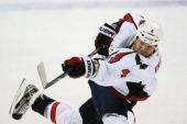 John Erskine of the Washington Capitals shoots the puck during a NHL game against the Florida Panthers at the BBT Center on February 12 2013 in...
