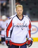 John Erskine of the Washington Capitals skates against the Calgary Flames during an NHL game at Scotiabank Saddledome on October 26 2013 in Calgary...