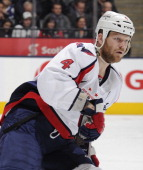 John Erskine of the Washington Capitals skates during NHL game action against the Toronto Maple Leafs January 31 2013 at the Air Canada Centre in...