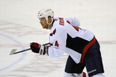 John Erskine of the Washington Capitals skates with the puck during a NHL game against the Florida Panthers at the BBT Center on April 6 2013 in...