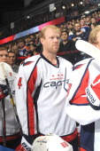 John Erskine of the Washington Capitals stands for the singing of the national anthem prior to a game against the Edmonton Oilers on October 24 2013...
