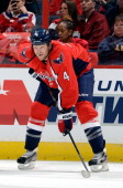 John Erskine of the Washington Capitals waits for a faceoff against the Nashville Predators during a preseason game at the Verizon Center on...