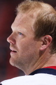 John Erskine of the Washington Capitals warms up on the ice prior to the start of the game against the Florida Panthers at the BBT Center on February...
