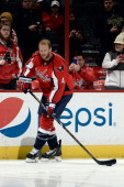 John Erskine of the Washington Capitals warms up prior to playing an NHL game against the Toronto Maple Leafs at Verizon Center on January 10 2014 in...