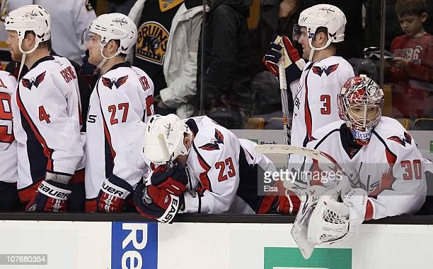 John ErskineKarl AlznerScott HannanTom Poti and Michal Neuvirth of the Washington Captials watch the last seconds of the game against the Boston...