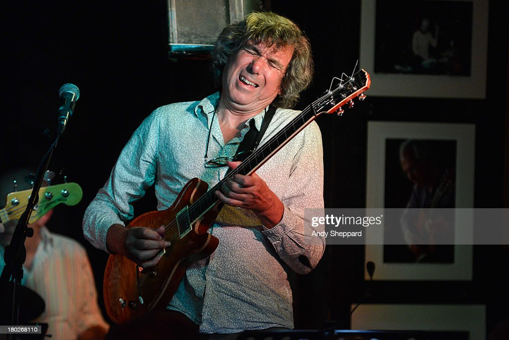 John Etheridge performs on stage at Pizza Express Jazz Club on September 10, 2013 in London, England.