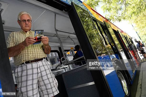 John Everton checks out the new 16th Street Free MallRide bus on display at Skyline Park on the 16th street mall on August 29 2016 in Denver Colorado...