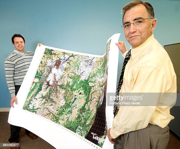 Monday December 17 2007 Larry Pixley and coworker Keith Bubblo hold up an aerial map of Northern Mongolia that they constructed using Google Earth...