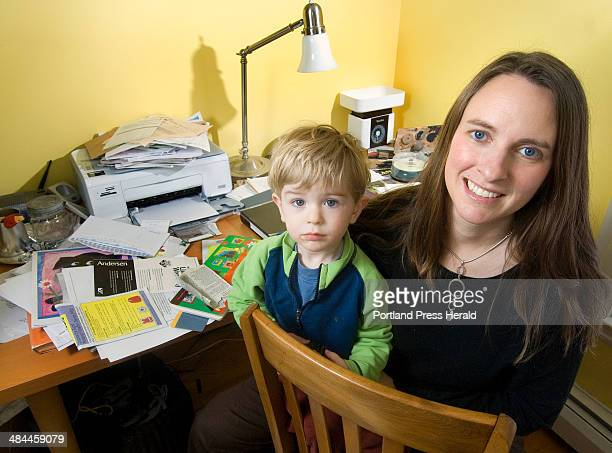 Thursday January 3 2008 Julie Falatko of South Portland here with her son Eli has spent the past year trying to declutter her home by throwing away...