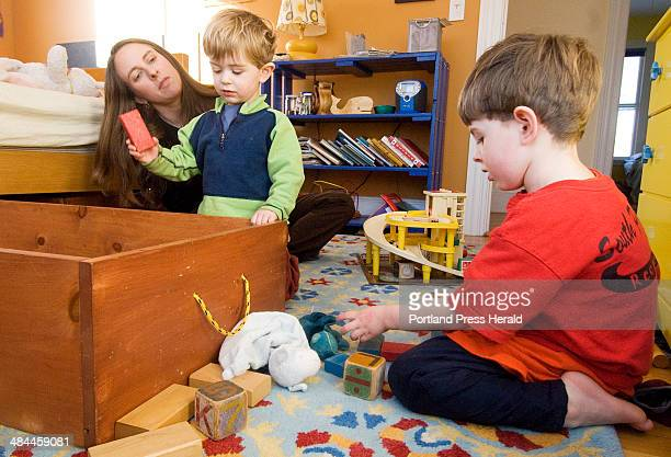 Thursday January 3 2008 Julie Falatko of South Portland and her sons Henry and Eli pick up a clutter of toys in the boys' bedroom Falatko has tried...