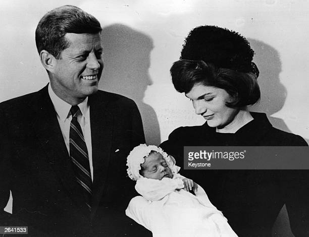 John F Kennedy American presidentelect with his wife Jacqueline at the christening of their son John F Jr in Washington