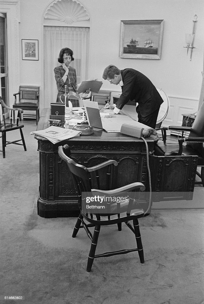 kennedy oval office. kennedy in the oval office john f and his secretary evelyn lincoln stand at desk