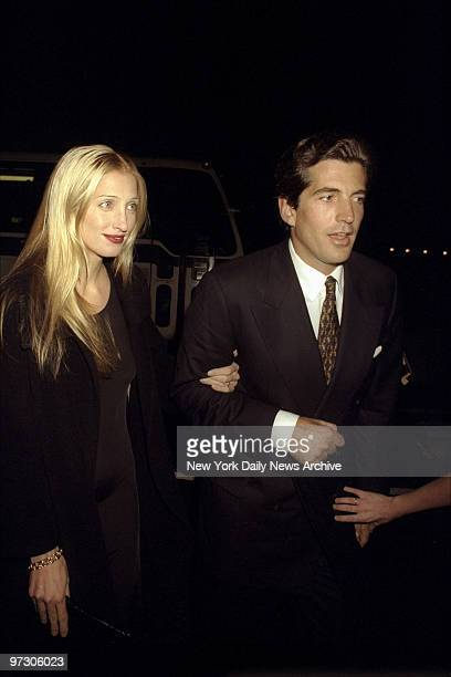 John F Kennedy Jr and his wife Carolyn Bessette arrive at Asia de Cuba restaurant for a party celebrating the second anniversary of Kennedy's...