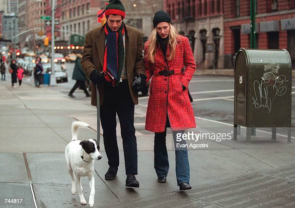 John F Kennedy Jr and his wife Carolyn walk with their dog January 1 1997 in New York City July 16 2000 marks the oneyear anniversary of the plane...