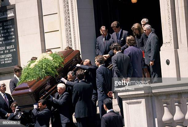 John F Kennedy Jr Caroline Kennedy and Edwin Schlossberg look on as the coffin of Jacqueline Kennedy Onassis exits St Ignatius Loyola Roman Catholic...