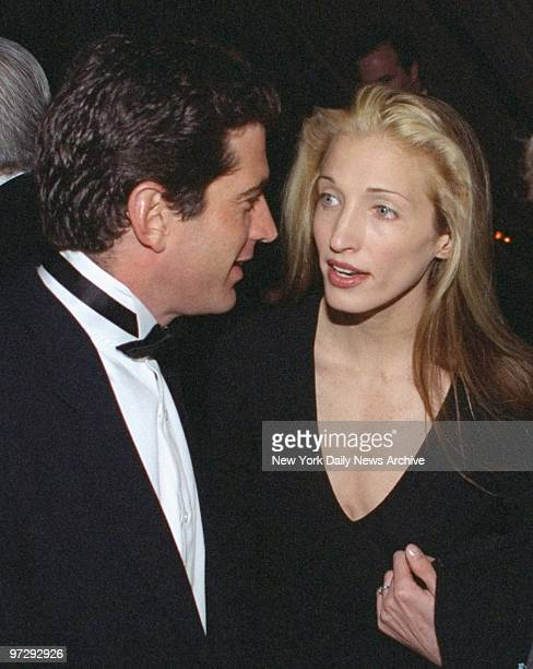 John F Kennedy Jr chats with his girlfriend Carolyn Bessette at the Municipal Art Society of New York benefit at the 69th Regiment Armory Kennedy and...