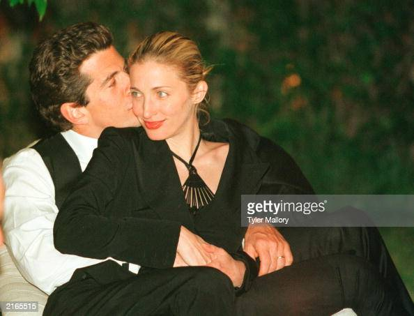 John F Kennedy Jr editor of George magazine gives his wife Carolyn Bessette Kennedy a kiss on the cheek during the annual White House Correspondents...