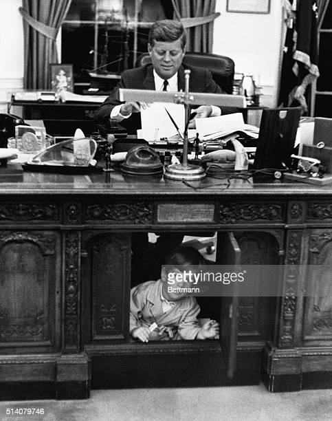 John F Kennedy Jr Exploring His Father's Desk