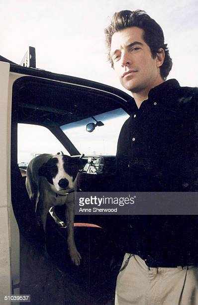 John F Kennedy Jr Gets Out Of A Truck With His Pet Dog 'Friday' December 30 1996 At A Montana Airport July 16 2000 Marks The OneYear Anniversary Of...