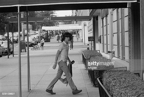 John F Kennedy Jr going into a building in NY circa 1970 New York