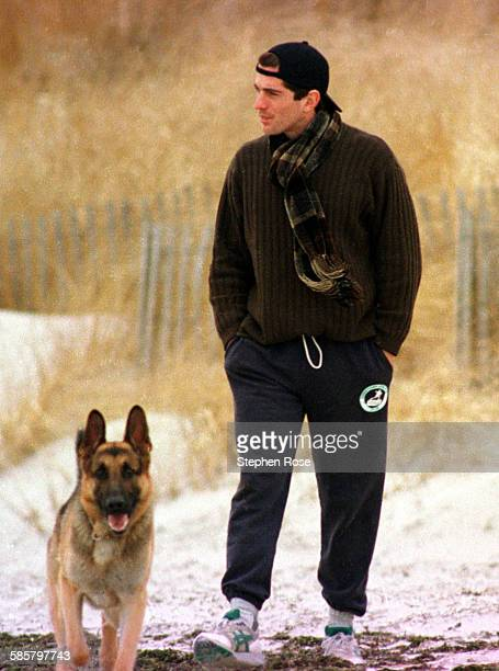 John F Kennedy Jr looks out to sea while walking with his dog along the beach in Hyannis Port Massachusetts the day after his grandmother Rose...